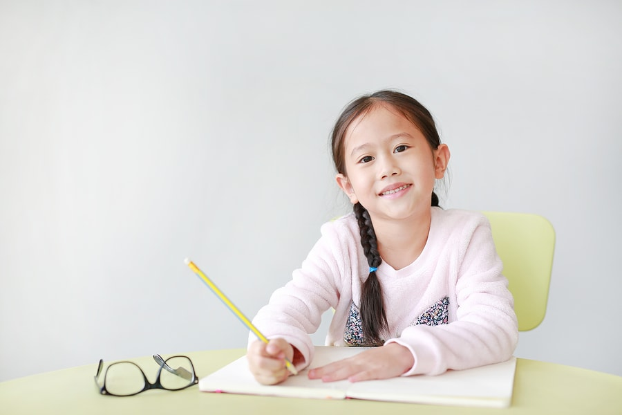 Girl at primary school maths tuition