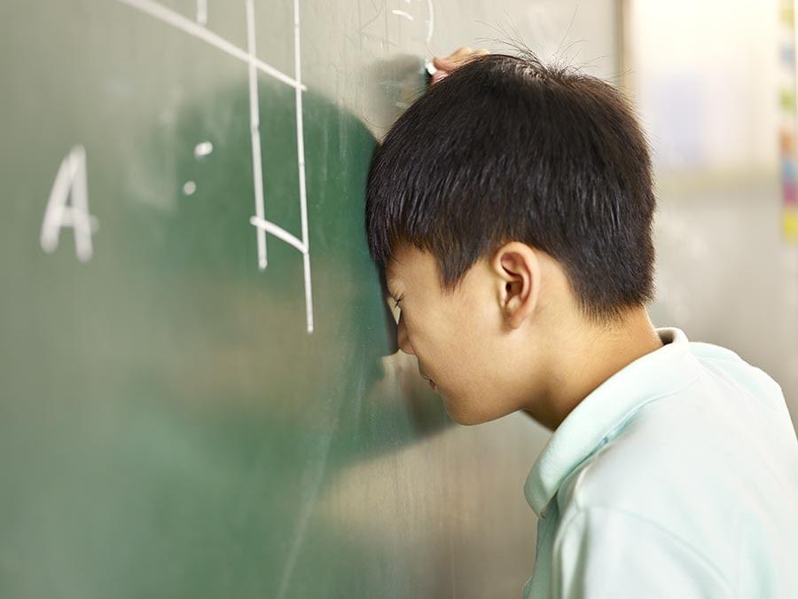 boy testing primary mathematics tuition Singapore