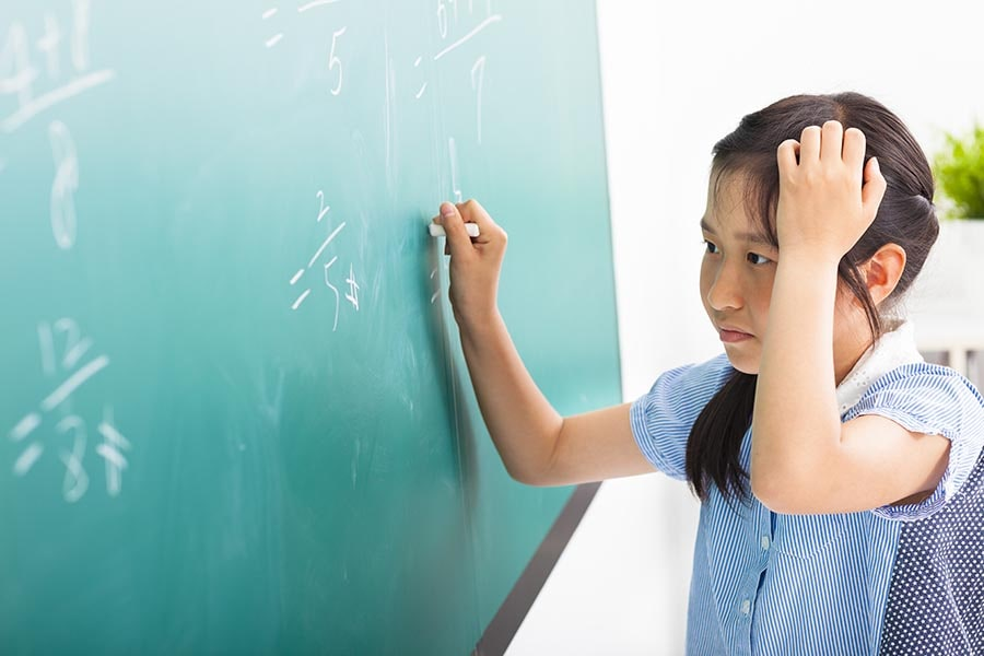 girl primary math tuition centre Singapore practice