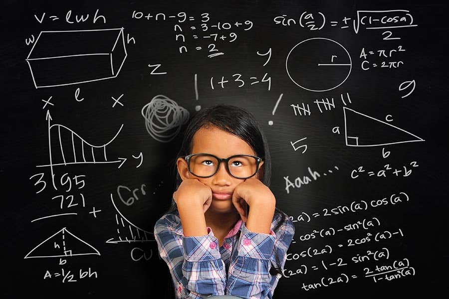 girl surrounded by maths concepts