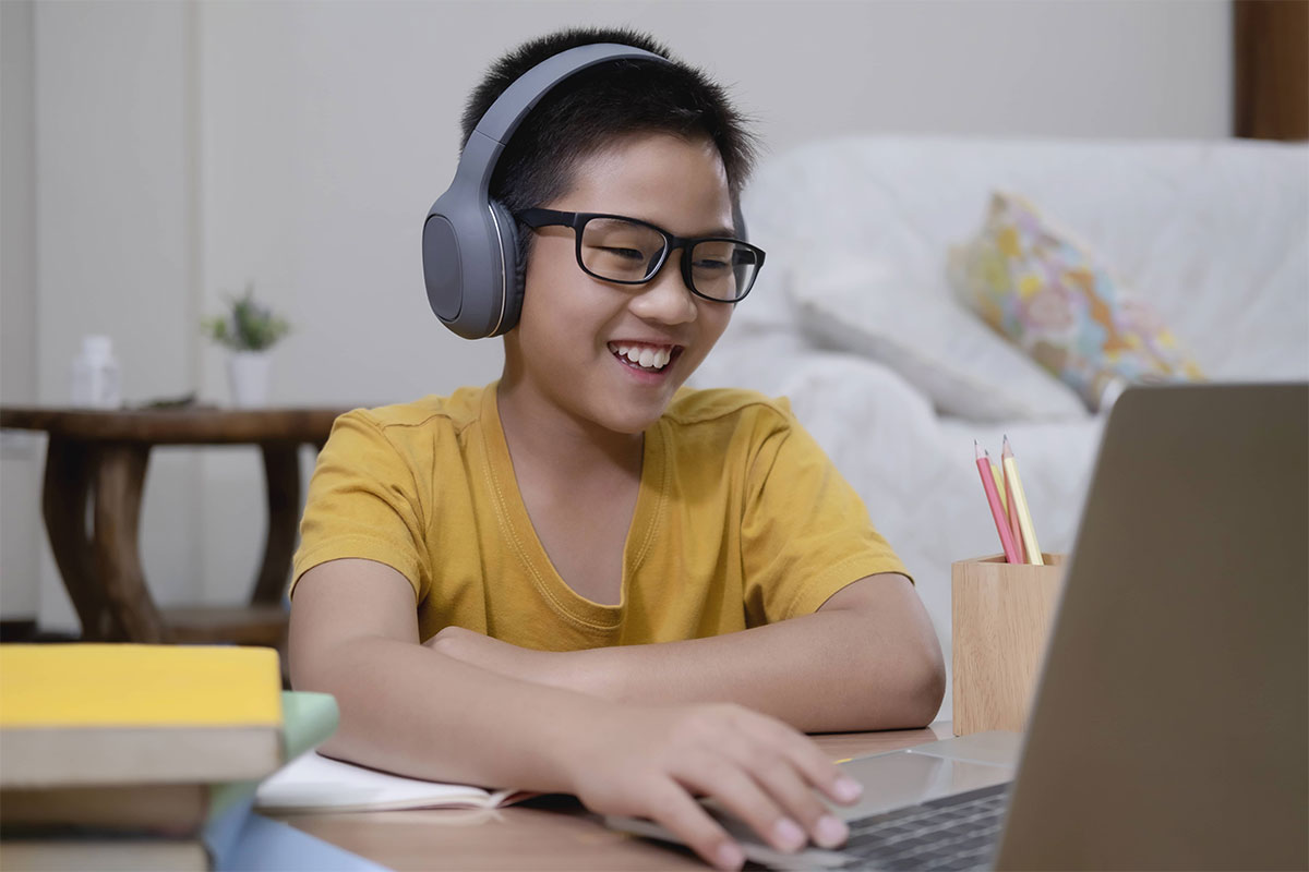 boy enjoying online math tuition class topic