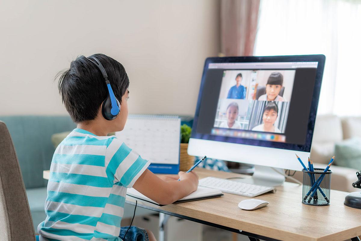 boy attending math class and listening to a teacher speak