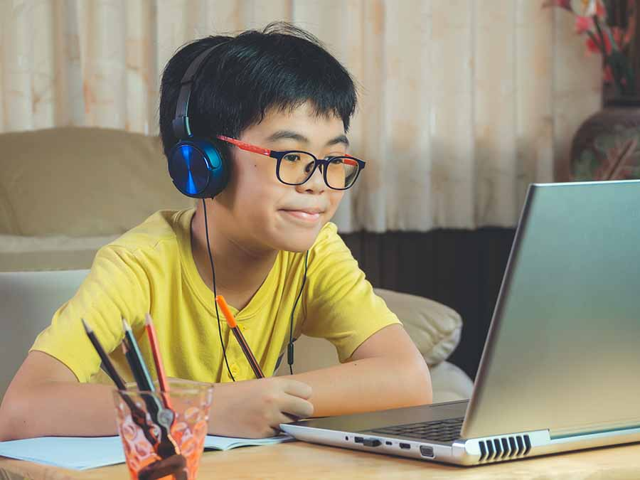 boy learning multiplication in an online lesson