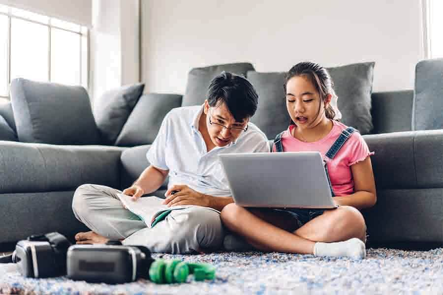 Parents sitting in for child's online math tuition